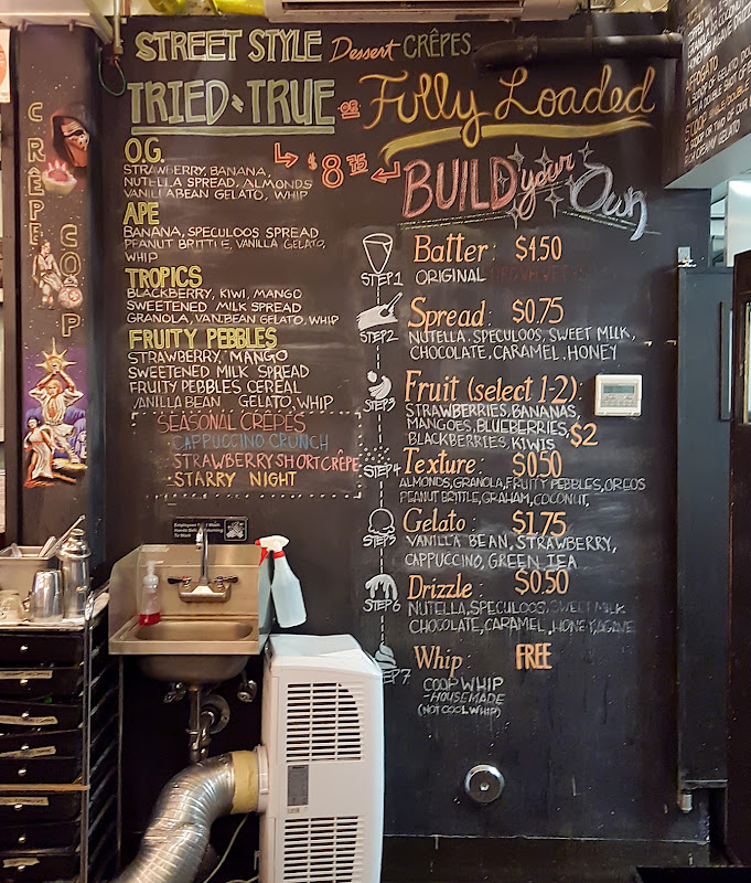 photo of a large chalkboard menu at Crêpe Coop
