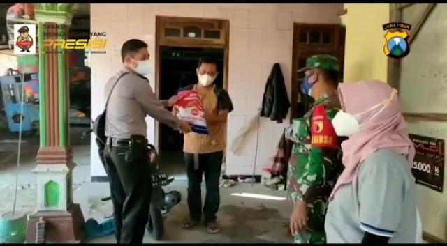 Penyaluran Bansos bagi masyarakat terdampak PPKM Level 4 oleh Polres Nganjuk