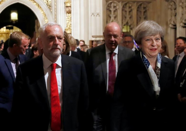 Britain's Prime Minister, Theresa May and opposition Labour Party leader Jeremy Corbyn, walk through the Peers Lobby in the Houses of Parliament during the State Opening of Parliament. Picture: REUTERS