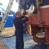 Crew member Neil Ceconi applying masking tape ahead of the paint job - 16 March 2015
