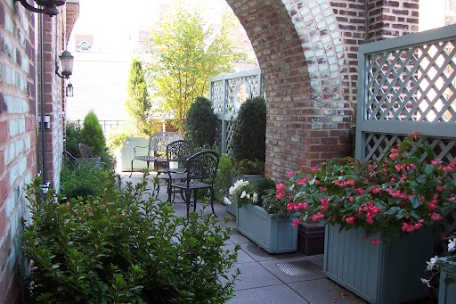 A brick arch defines a terrace.