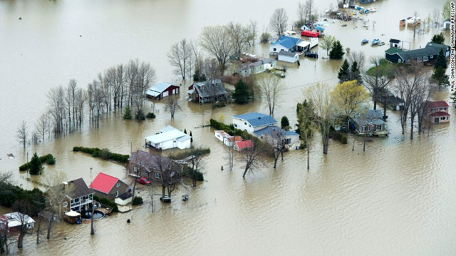 The Ottawa River floods homes in Rigaud, Quebec, on 8 May 2017. There were mandatory evacuations in Rigaud as well as Pontiac and Montreal. Photo: Paul Chiasson / The Canadian Press / AP