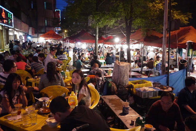dining alfresco at Zhengning Street Night Market in Lanzhou, China
