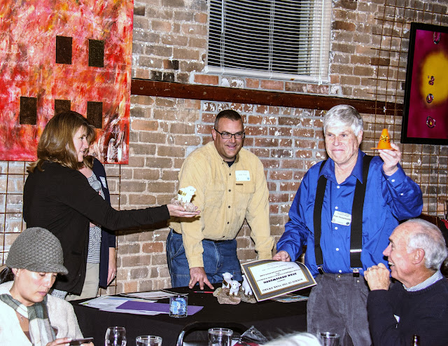 Volunteer Stan receiving Ambassador Award fm Ranger Stacey