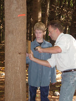 Installing Trail Markers 1 Verse plaque nailed to tree