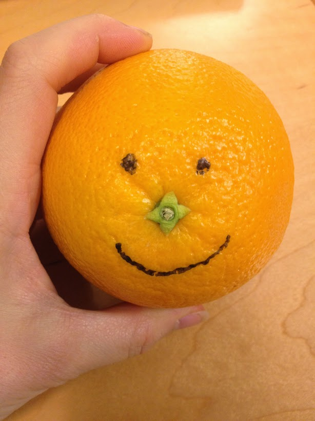 Orange with smiley face