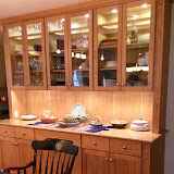 Hutch in Natural Cherry with LED puck lights and under-cabinet lights.