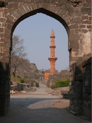 A minaret viewed through an Indian arch