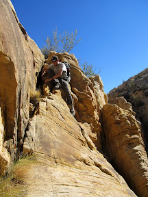 Climbing down into Spring Canyon above the drop