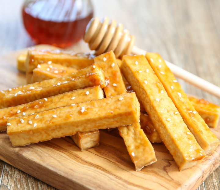 photo of Baked Honey Garlic Tofu Fries garnished with sesame seeds