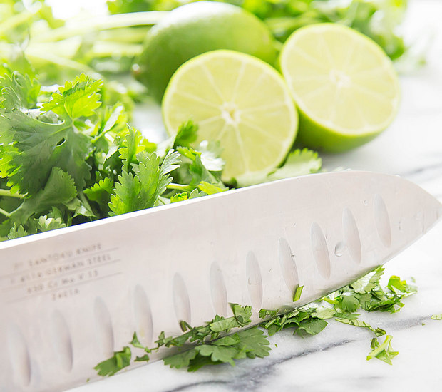 photo of knife chopping fresh cilantro