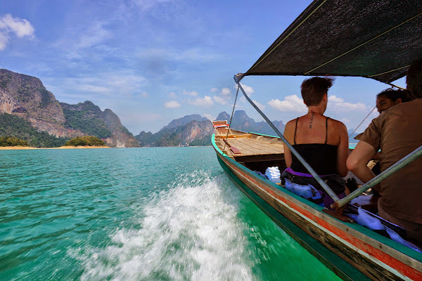Explore the Cheow Larn Lake by traditional longtail boat
