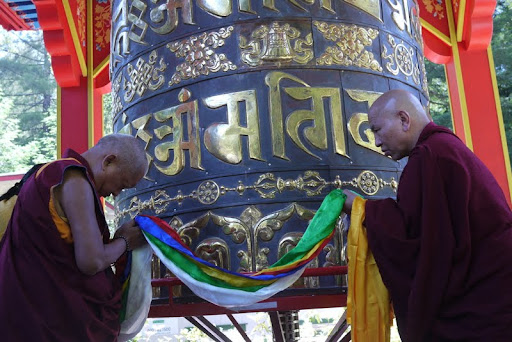 Lama Zopa Rinpoche consecrating the finished large prayer wheel at Land of Medicine Buddha.