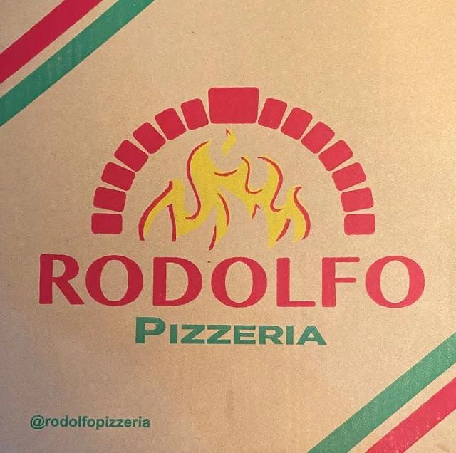 A box of Rodolfo Pizzeria pizza