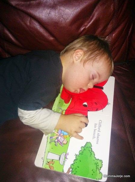 Toddler asleep on board book: Clifford