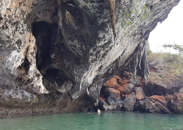 Exploring the sea caves of Phra Nang Beach at low tide.