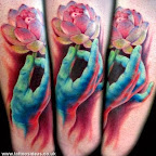 hand holding a flower - tattoos for men