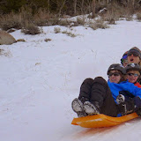 Shelli, with her three sons, on a screaming downhill sledding run.