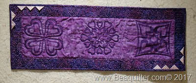 Purple batik table topper with prairie points1