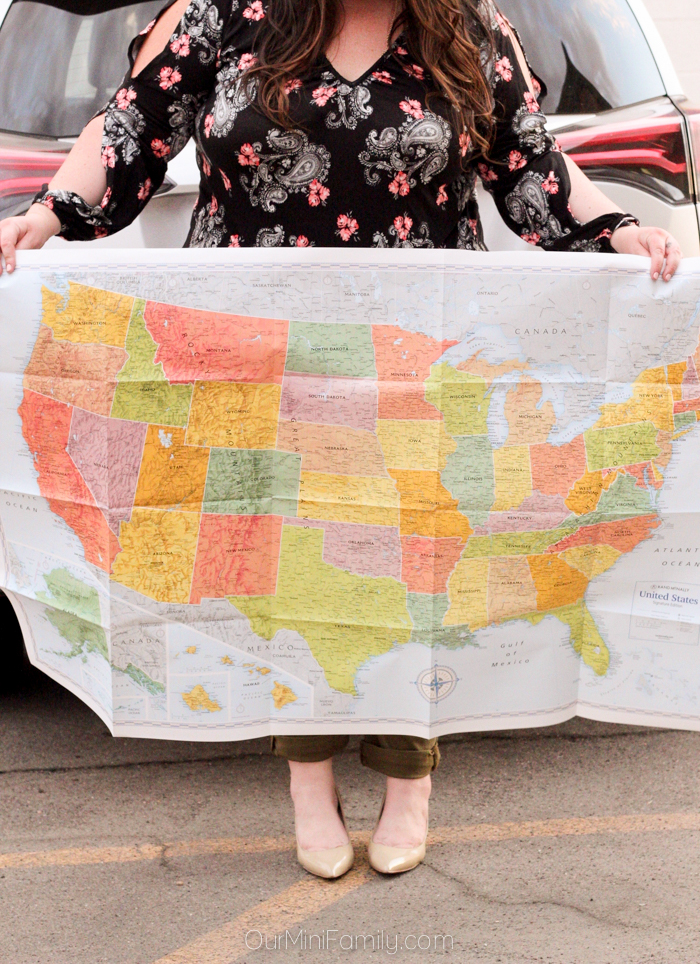 woman's body holding a large United States Map
