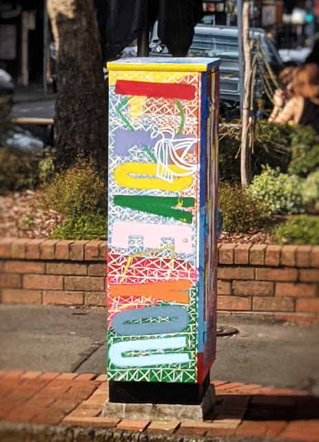 Photo of a street box painted with the words I Love You