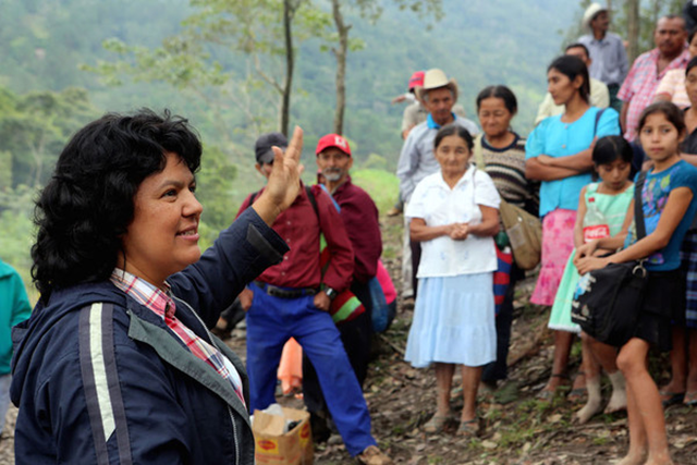 In this 27 January 2015 photo released by The Goldman Environmental Prize, Berta Caceres speaks to people near the Gualcarque river located in the Intibuca department of Honduras. Caceres, the COPINH (the Council of Popular and Indigenous Organizations of Honduras) and residents of the region have maintained a two year struggle to halt construction on the Agua Zarca Hydroelectric project. On 3 March 2016, a member of her indian council group says at least two assailants broke into her home and shot Caceres to death. She won the 2015 Goldman Environmental Prize for her role in fighting the dam project. Photo: Tim Russo / Goldman Environmental Prize