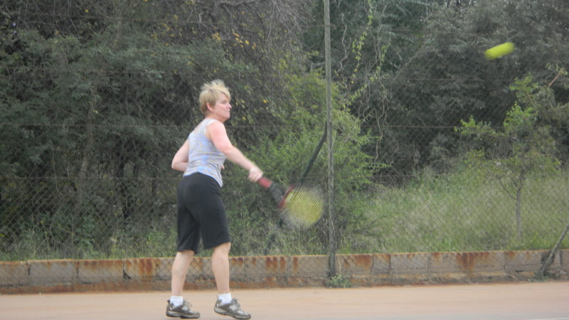 Tish swinging the racket