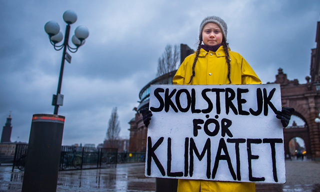 Greta Thunberg during her Friday, 30 November 2018 climate change protest. Greta, 15, began a solo climate protest by striking from school in Sweden in August 2018. But more than 20,000 students around the world have now joined her. The school strikes have spread to at least 270 towns and cities in countries across the world, including Australia, the United Kingdom, Belgium, the US, and Japan. Photo: Hanna Franzen / EPA