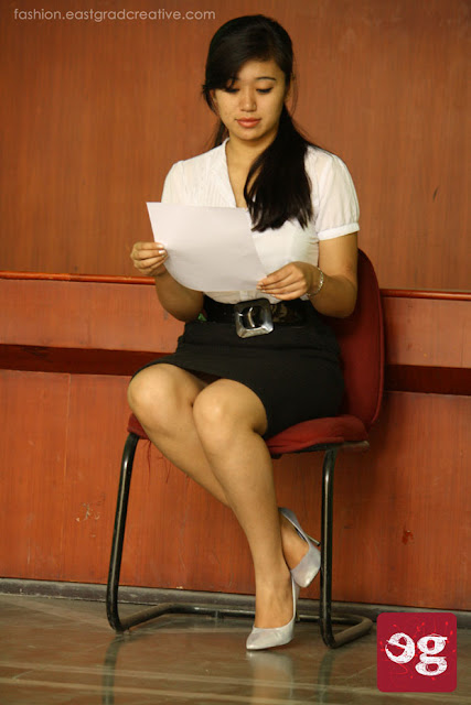Black pencil skirt, white formal shirt and pair of heels.
