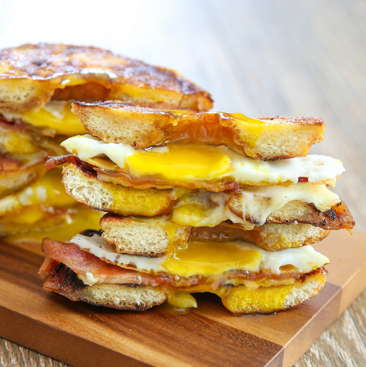 close-up photo of a stack of Grilled Cheese Donut Breakfast Sandwiches