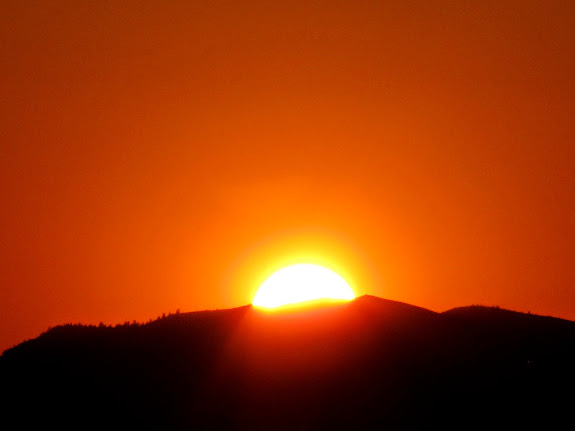 The sun disappearing behind the Wasatch Plateau