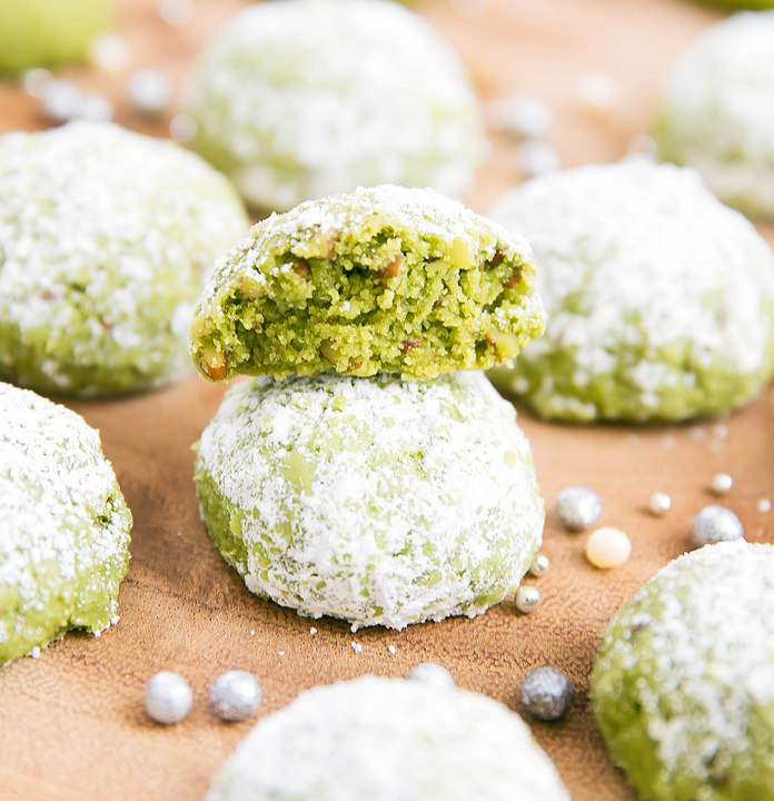 close-up of a matcha snowball cookie cut in half