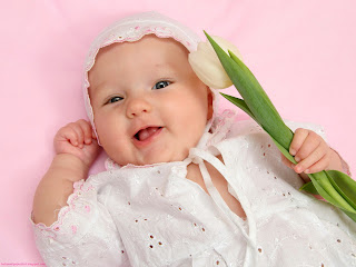 Cute Baby Girl and Flower