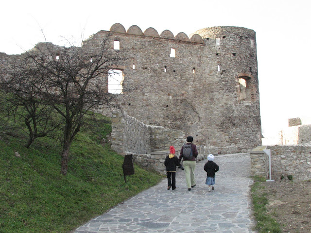 Our family at castle ruins in Slovakia, one of the cheap European destinations recommended in the book.