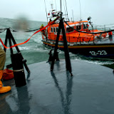 Close encounters - Poole crew member clipped on with his safety harness on the foredeck during an exercise with Swanage lifeboat in rough weather - 26 January 2014 Photo: RNLI Poole/Rob Inett