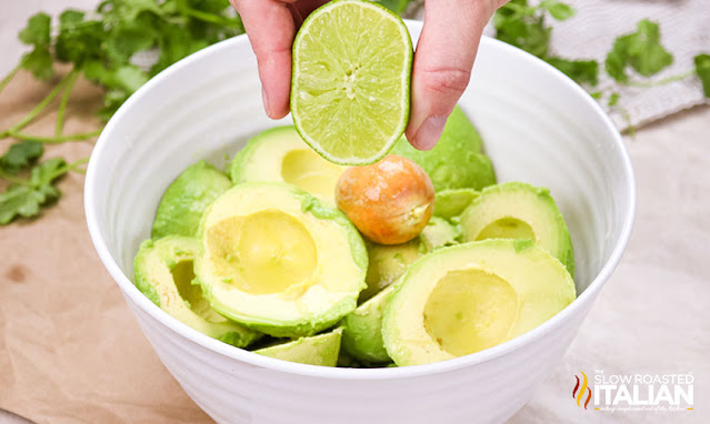Chipotle Guacamole Recipe squeezing lime over guac