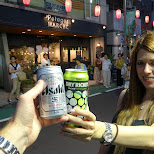 heather and I cheersing at the awa odori matsuri in nakameguro in Meguro, Tokyo, Japan