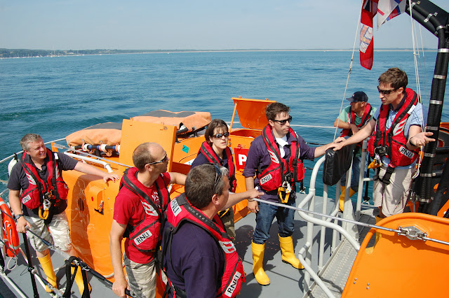 Crew Member Oli Mallinson providing feedback to the crew after practising in Poole Bay Photo: RNLI Poole/Dave Riley
