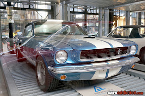 Blue Ford Mustang with white stripes