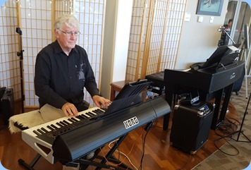 Gordon Sutherland playing his Korg Pa4X using a Samsung Tablet with the score music.