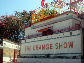 some Texas nut transformed a small suburban lot near his wood frame house into The Orange Show in honor of his favorite fruit.