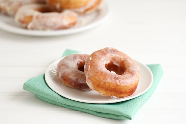 photo of two glazed donuts on a plate