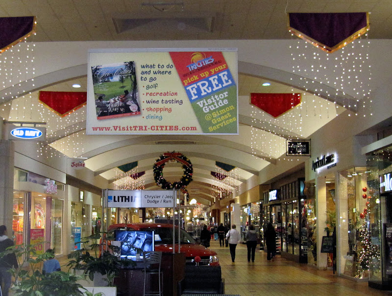 A large banner ad in a shopping mall.
