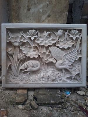 Relief batu alam paras jogja motif lotus dan angsa