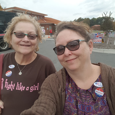 Mom and me outside board of elections with our I just voted stickers