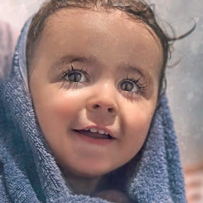 Cozy in the snow by Laura Prieto - Babies & Children Babies ( cozy, cold, blue, snow, towel, christmas, baby, lashes, cute smile, smile, add, baby boy, eyes,  )
