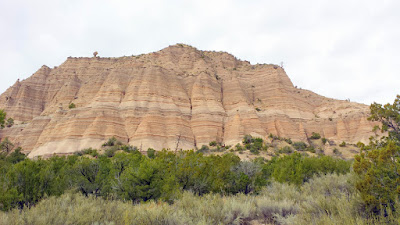 Kasha-Katuwe Tent Rocks National Monument 40 miles S of Sante Fe. Kasha-Katuwe means White Cliffs in the Keresan language of the nearby Cochiti Pueblo. It so happened that there was a big rain storm system that went through earlier in the week though, so instead of being white there is some color in the rock from the absorbed moisture that show off the layers