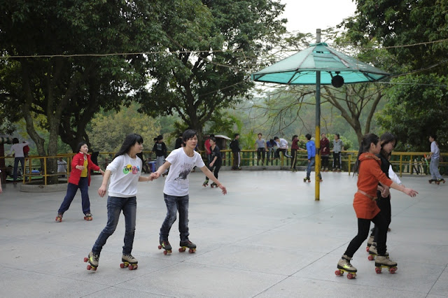 young people roller skating at Bailian Dong park in Zhuhai China