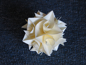 Cuboctahedron from Curler Units by Herman Van Goubergen at http://www.britishorigami.info/academic/curler.php