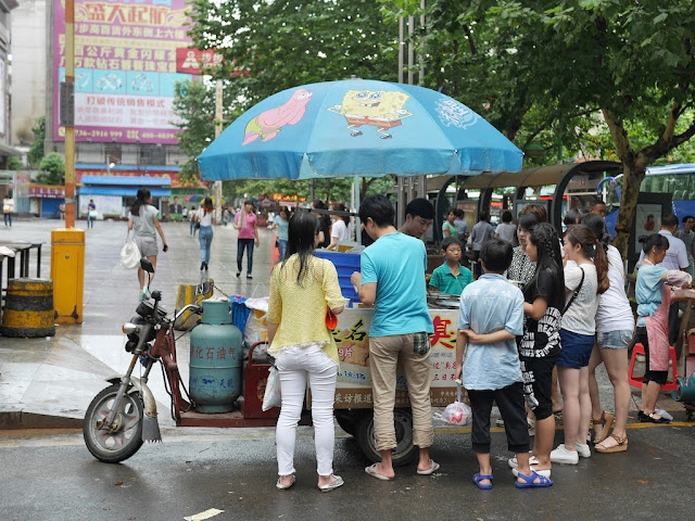 motorized tricycle food cart with a SpongeBob SquarePants umbrella